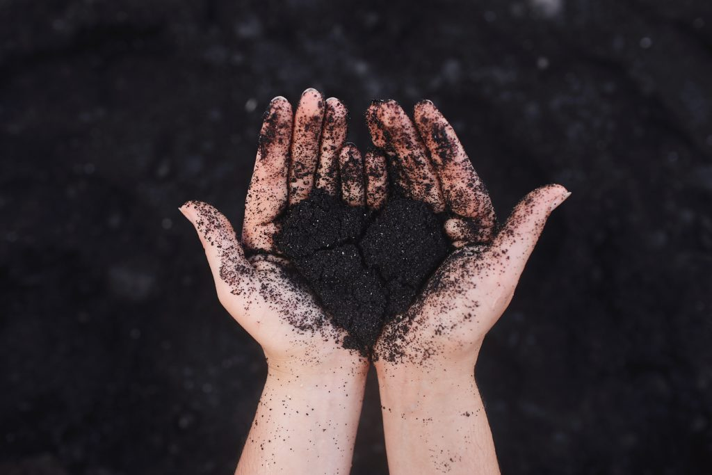 hands-hold-dirt-shaped-in-heart-form